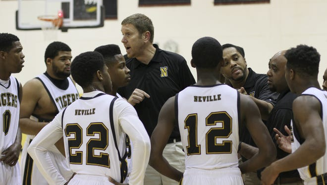 Neville coach Phillip Craig (center) and the Tigers have won seven games in-a-row after a slow start.