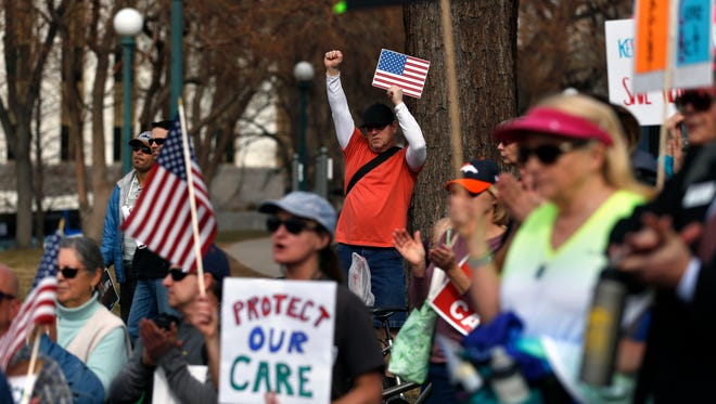 Supporters of the Affordable Care Act who are also opponents of Colorado's GOP-led plan to undo Colorado's state-run insurance exchange gather for a rally organized by the national Save My Care Bus Tour, on the state Capitol steps in Denver, Tuesday, Feb. 7, 2017.