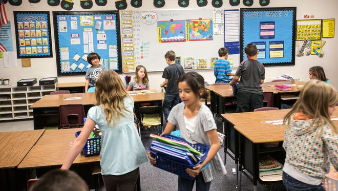 Students at Burk Elementary, a Gilbert public school, read in their classroom on March 31, 2015.