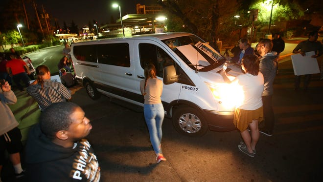 Guadalupe Garcia de Rayos is locked in a van that is stopped bu protesters outside the ICE office on Feb. 8, 2017 in Phoenix.