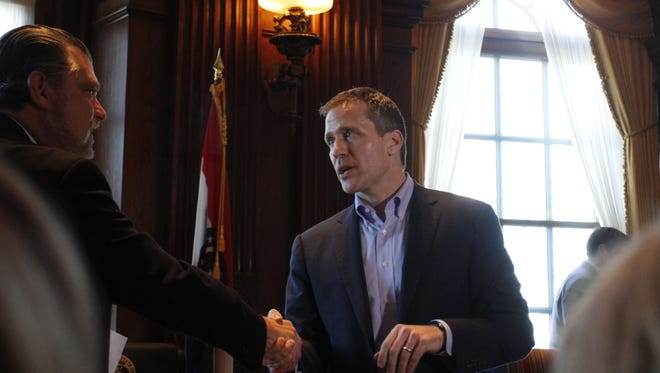 Gov. Eric Greitens, right, shakes hands after being introduced by Jeff Schrag, publisher of The Daily Events and current president of the Missouri Press Association, on Thursday, March 2, 2017, in the governor's office in Jefferson City.