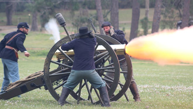 Union re-enactors brace for the blast of their cannon on Saturday during a battle recreation in Pineville. The event was part of the annual Blue and Gray on the Red events that detailed local Civil War history.