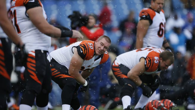 Offensive lineman T.J. Johnson (60), center, has been tendered an offer by the Cincinnati Bengals for the 2017 season.