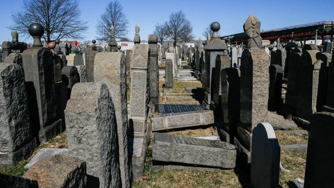 Toppled headstones remain on the ground at Washington Cemetery in Brooklyn on March 5, 2017.