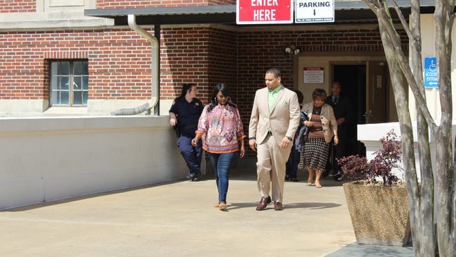 Derrick Stafford (right) leaves the Avoyelles Parish Courthouse on Monday for lunch. Testimony was hearing Monday in his trial on second-degree murder and attempted second-degree murder charges.