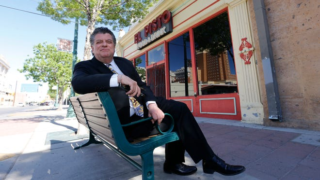 """BusinessmanWilliam """"Billy"""" Abraham sits in front of the century-old Chinese laundry building in Downtown El Paso. The building will no longer be considered for the state's highest historical designation after Abraham withdrew its application this week."""