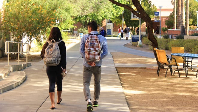 Students walk around the campus of Phoenix College, one branch of the local Maricopa Community College system.