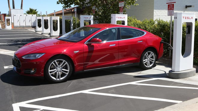 A Tesla recharges at a Supercharging Station in Buellton Calif.