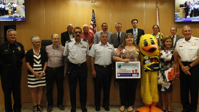 """The Marco Island City Council poses with members of the NCH Safe & Healthy Children's Coalition on Monday, May 3. The council proclaimed May """"Drowning Prevention Month."""""""