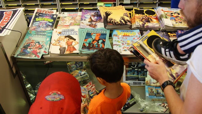 Hundreds line up to choose three free comics at Tony's Kingdom of Comics and Collectibles in Keizer on Free Comic Day on Saturday, May 6, 2017.