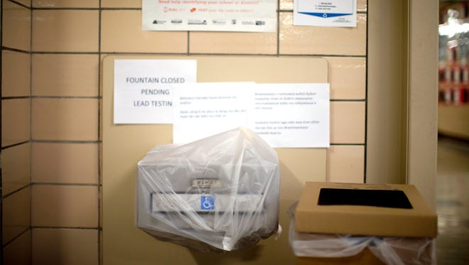 In this May 31, 2016, file photo, a water fountain is covered because of lead in the drinking water at Creston Elementary School in Portland, Ore. An upcoming $790 bond measure for the Portland Public Schools would be the largest in state history. Proponents say the money is desperately needed to repair and update infrastructure at the city's schools, which last summer made national headlines after toxic levels of lead were found in school water fountains.