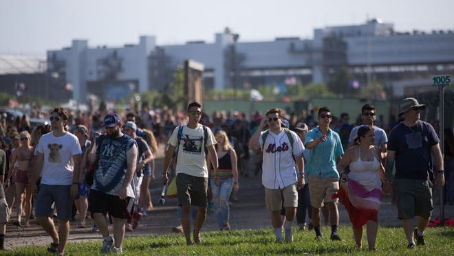 Fans pour into The Woodlands in Dover, Del. for Firefly Music Festival Thursday.