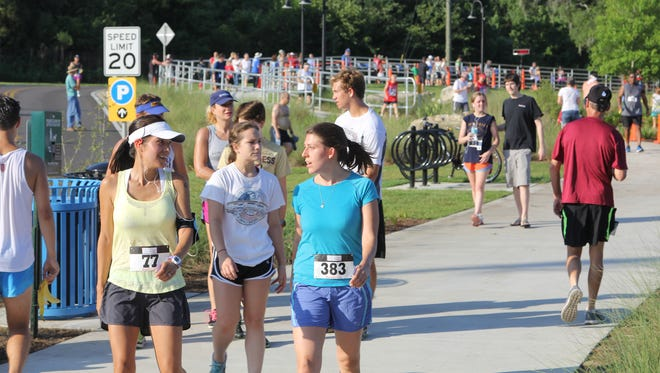 Walkers catch their breath after finishing the Kiwanis Club of Tallahassee's 32nd Annual Firecracker 5K and 1 Mile Fun Run in 2014.