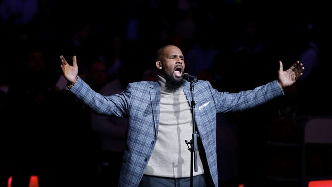 R. Kelly performs the national anthem before an NBA basketball game between the Brooklyn Nets and the Atlanta Hawks Tuesday, Nov. 17, 2015.