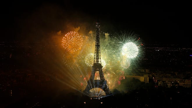 A view of  the fireworks display by the Eiffel tower on Bastille Day, in Paris, France, Friday, July 14, 2017.