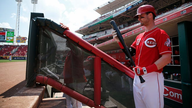 Cincinnati Reds right fielder Jesse Winker (33) prepares to take the on-deck circle in the bottom of the fourth inning of the game between the Cincinnati Reds and the San Diego Padres at Great American Ball Park on Thursday.