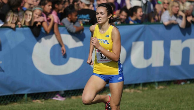 2016 third place finisher, Maddie Dalton, from Carmel, crosses the finish line during the IHSAA cross-country state finals, held in Terre Haute IN, at LaVern Gibson Championship Cross Country Course and Wabash Valley Sports Center, Saturday october 29th, 2016.