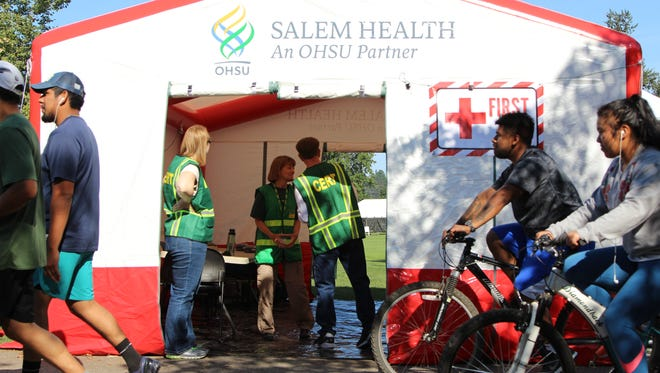 Salem Fire and CERT officials prepare a triage tent at Riverfront Park in Salem on Saturday, August 19, 2017. Salem Health provided the tent to officials to provide emergency care for park visitors during eclipse festivities.