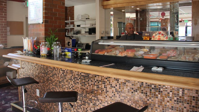 Chef Simon Waswo stands behind his sushi counter at Su T Bar, the new Japanese restaurant in North Salem.