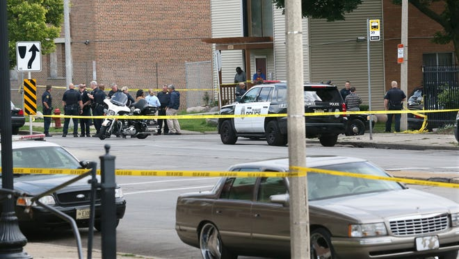 Police block off a section of Wisconsin Ave. searching for evidence and interviewing witnesses near N.29th St. and W. Wisconsin Ave.