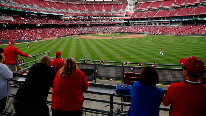 Fans watch from the stands in right-center field during the top of the seventh inning during the game between the Cincinnati Reds and the Milwaukee Brewers at Great American Ball Park on Sept. 6.
