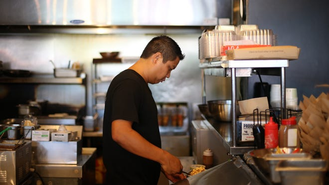 Viet Vu works inside Taco Republik, one of the local restaurants he owns with his brother Nam, on Wednesday, June 14, 2017.