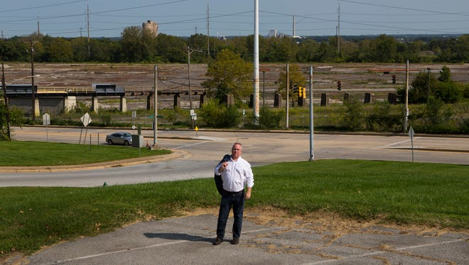 Brett Saddler, executive director of the Claymont Renaissance Development Corp., stands in front of the former Evraz Claymont Steel site where Saddler believes Amazon could build a new headquarters.