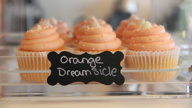 Orange Dreamsicle cupcakes at Brandy's All City Sweets come topped with orange cream cheese frosting.