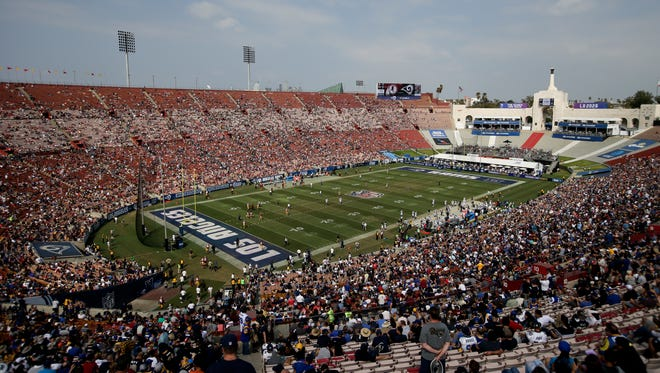 Fans watch in this general view of LA Memorial Coliseum during the second half of an NFL football game between the Los Angeles Rams and the Washington Redskins Sunday, Sept. 17, 2017, in Los Angeles.