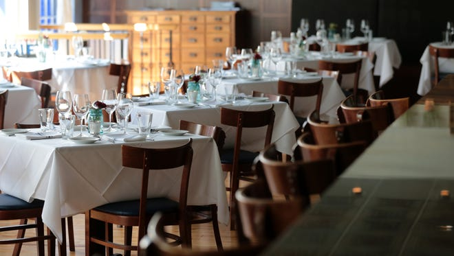 View of the main dining room, pictured, Friday, Sept. 29, 2017, at Postmark Restaurant in Cincinnati's Clifton neighborhood.