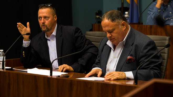 Wilmington City Council member Bob Williams, left, explains the benefits of implementing a gun offender registry in the city during a meeting Monday in the City Council Committee Room.