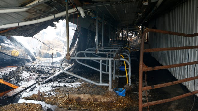 The milking parlor at Aukema Dairy Farm in Chenango Forks on Wednesday October 11, 2017.  A fire engulfed the dairy barn on Tuesday evening.