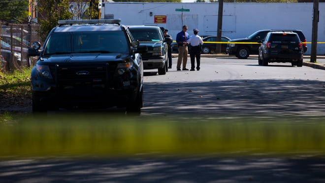 Police investigate the scene of a shooting at 28th Street Auto Sales and Services on the corner of E 28th and Northeast Boulevard Wednesday in Wilmington.