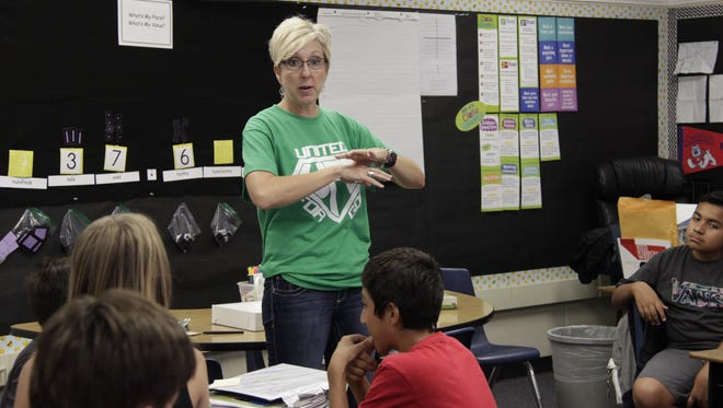 Sixth-grade teacher Staci Copley gives directions to her class at Frank Kohn Elementary School in Tulare Wednesday morning. Copley returned to Tulare this year to teach for Tulare City School District.
