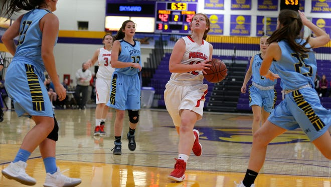 Pacelli player Emma Van Order moves towards the basket during the Sentry Classic basketball tournament at the University of Wisconsin-Stevens Point in Stevens Point, Wis., December 28, 2017.