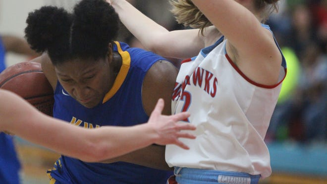 Sydnee Roby (left) drives for Milwaukee King against Arrowhead on Jan. 26. Both teams earned No. 1 seeds for the WIAA tournament.