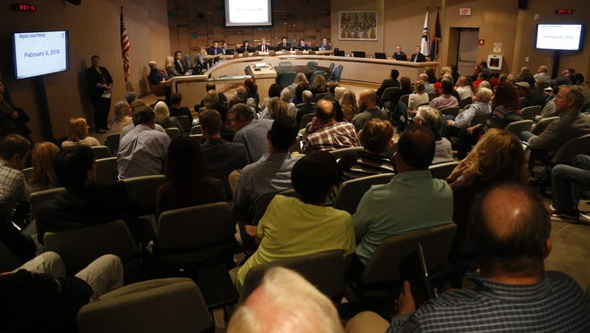 People gather to listen to debate on a proposed Quick Quack Car Wash during the Tempe City Ccouncil meeting at the Tempe Municipal Building on Feb. 8, 2018, in Tempe.