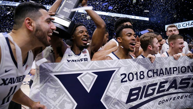 The Xavier Musketeers celebrate with the Big East regular season championship trophy after the NCAA Big East game between the Xavier Musketeers and the Providence Friars at the Cintas Center in Cincinnati on Wednesday, Feb. 28, 2018. The Musketeer won its first-ever Big East regular season title with an 84-74 win over Providence.