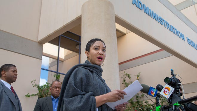 Janelle Wood, the founder of the Black Mothers Forum, along with Matthew Whitaker (left) and Lynn Burnett, holds a press conference outside Kyrene School District Office demanding San Tan Junior High School and Chandler Unified School District enforce their school policies and Code of Conduct following a racist Snapchat video that surfaced in which students were not punished.