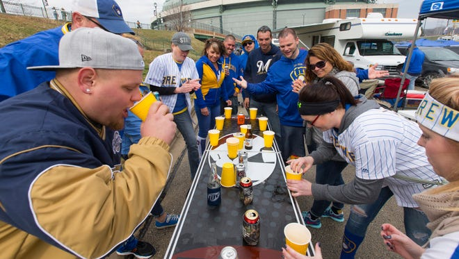 Fans play Flip Cup in the parking lot at Miller Park before the Milwaukee Brewers' 2017 home opener against the Colorado Rockies.