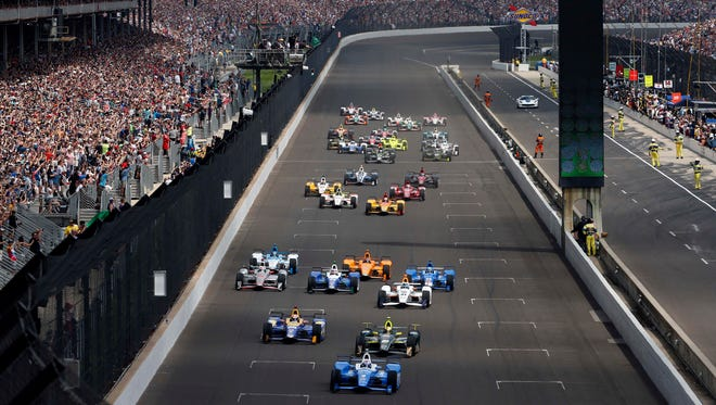 Scott Dixon, front, leads the field to green after winning the pole for the 2017 Indianapolis 500.