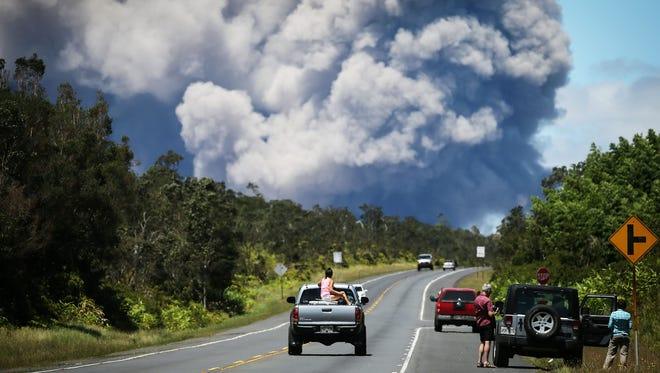 An ash plume rises from the Kilauea volcano on Hawaii's Big Island on May 15, 2018 in Volcano, Hawaii. The U.S. Geological Survey said a recent lowering of the lava lake at the volcano's Halemaumau crater 'has raised the potential for explosive eruptions' at the volcano.