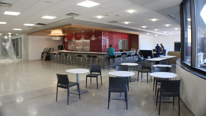 Workers put the final touches on the airport's restaurant/lounge on Friday.