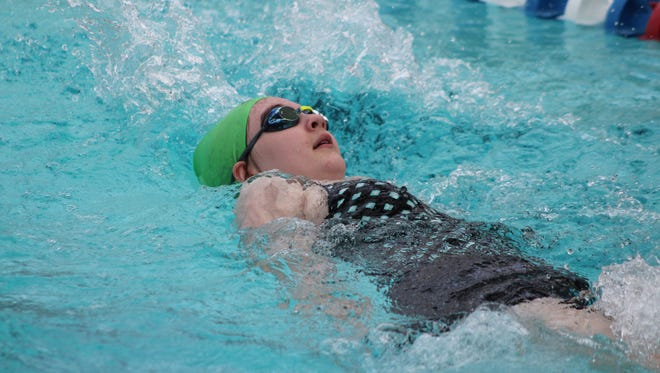 Peyton Schaffner competes in the backstroke Saturday at Batesville.
