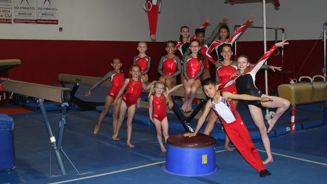 First place event and all around champions. Front Row: Abeline Torres, Emilee Francis, Kennedy Sapyta and Aidyn Rodriguez. Second row: Kimber Lockridge, Amber Ortiz, Marisol Gallegos, Leilany Diaz and Riley Moulton. Third Row: Rylee Atchley, Kaylie Harvey and Audrey Barrio​. On the rings: Xander Moulton; on the pommel horse: Carson Kaczmarek. Not pictured: Jack Robertson, Emilio Trejo and Valeria Colato.