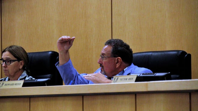 Councilor Howard Reed gestures to the members of Marco Island City Council where he believes the bar should be set for a new city manager.