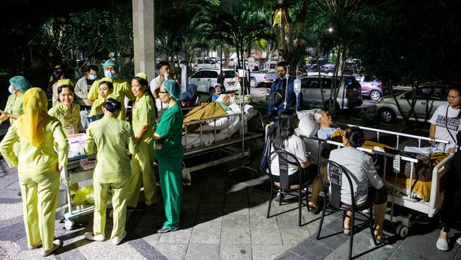 Hospital patients are moved outside of the hospital building after an earthquake was felt in Denpasar, Bali, Indonesia on Aug. 5, 2018. Reports state that the magnitude 7.0 earthquake was centered on the Indonesian island of Lombok nearby of Bali.