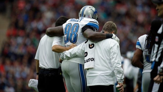 Detroit Lions defensive tackle Nick Fairley (98) is carried off of the field in the first half at Wembley Stadium in London on Sunday, Oct. 26, 2014.