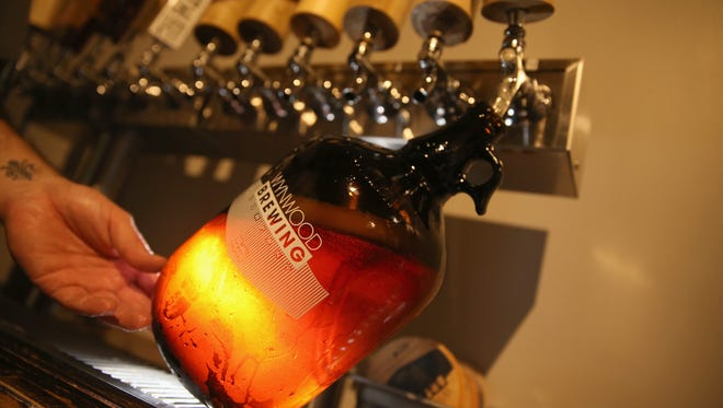 A growler of beer is poured at Wynwood Brewing Company in Miami, Florida.