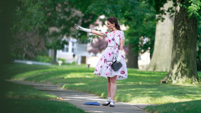 Katie Holmes is a prim teacher with the deadly aim in 'Miss Meadows.'